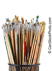 paintbrushes in black holder cup