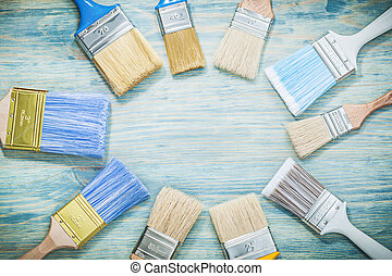Paintbrushes on wooden board construction concept