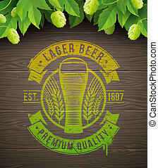 Painted beer emblem and ripe hops
