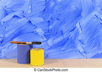 Painted blue wall with paint tins