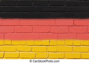 Painted brick wall in the colors of the flag of Germany.
