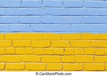 Painted brick wall in the colors of the Ukrainian flag.