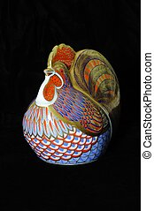 Colourfully painted china cockerel paperweight.