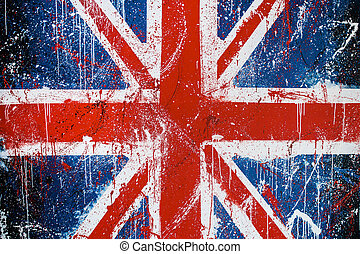 Painted concrete wall with graffiti of British flag. Grunge...