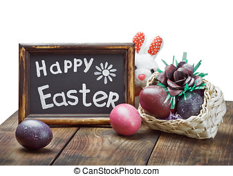 Painted Easter eggs in a basket on the table with a...