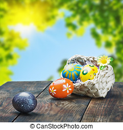 Painted Easter eggs in a basket on the table