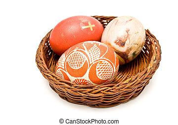 Painted easter eggs in brown basket