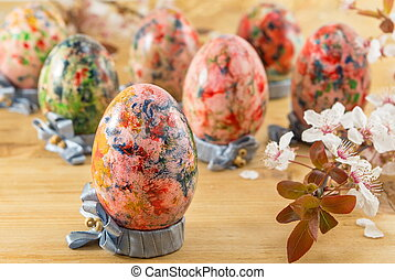 Painted Easter eggs in custom egg holders