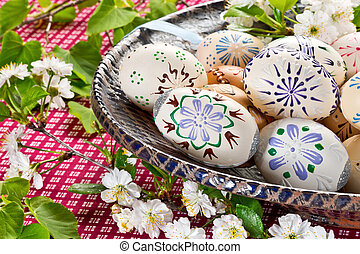 Painted Easter eggs in the blue bowl