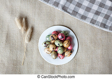 Painted easter eggs lying on white plate