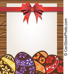 Painted  Easter eggs on the wooden fence background