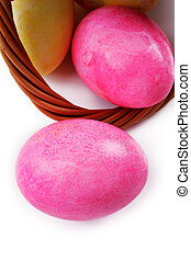 Painted Easter eggs with basket on a white background
