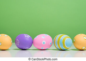 Painted Easter eggs with copy space on background