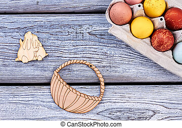 Painted eggs on wooden surface.