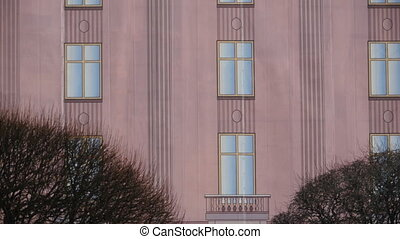 painted facade of a building with windows, the theatrical scenery flutters in the wind