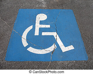 Painted handicap parking place sign on the street