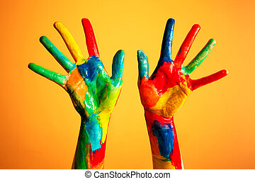 Painted hands, colorful fun. Orange background - Painted...