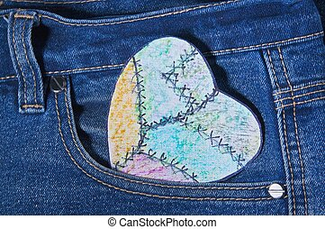 painted heart paper in jeans pocket