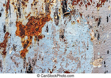 Painted iron background with a large rusty spot and metal corrosion.
