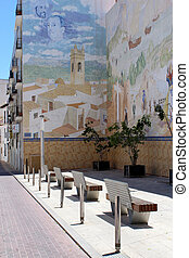 Painted Mural at Plaza D. Manuel Miro, calle mar, historic old town center, Calp, Spain. Mediterranean spanish coastal city (Costa Blanca).