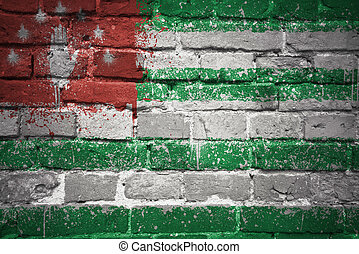painted national flag of abkhazia on a brick wall