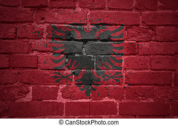 painted national flag of albania on a brick wall