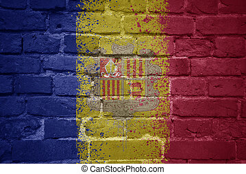 painted national flag of andorra on a brick wall