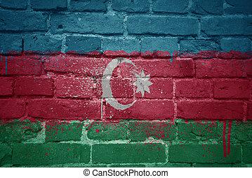 painted national flag of azerbaijan on a brick wall