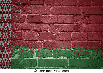 painted national flag of belarus on a brick wall