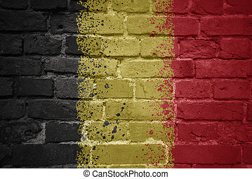 painted national flag of belgium on a brick wall