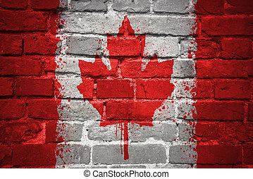 painted national flag of canada on a brick wall