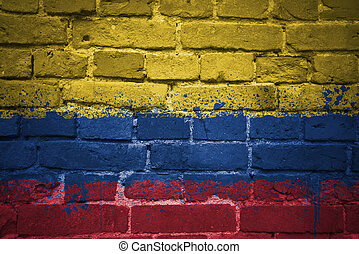 painted national flag of colombia on a brick wall