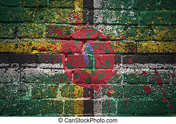painted national flag of dominica on a brick wall
