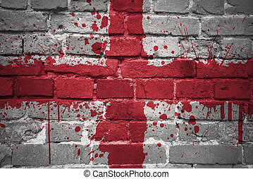painted national flag of england on a brick wall