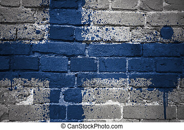 painted national flag of finland on a brick wall