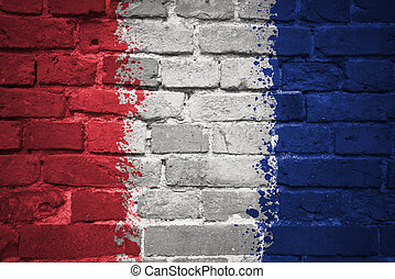 painted national flag of france on a brick wall