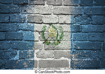 painted national flag of guatemala on a brick wall