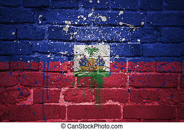 painted national flag of haiti on a brick wall