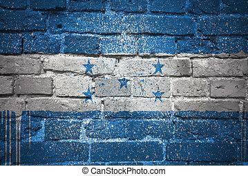painted national flag of honduras on a brick wall