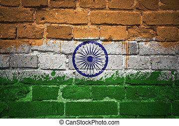painted national flag of india on a brick wall