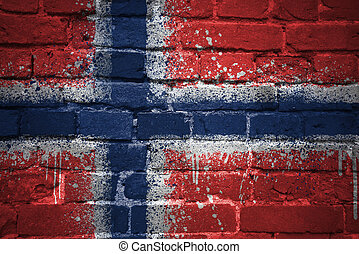 painted national flag of norway on a brick wall