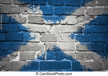 painted national flag of scotland on a brick wall