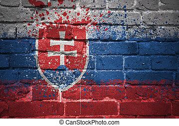 painted national flag of slovakia on a brick wall