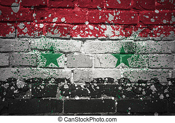 painted national flag of syria on a brick wall