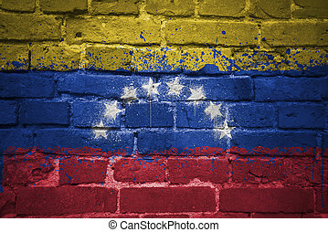 painted national flag of venezuela on a brick wall
