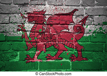 painted national flag of wales on a brick wall