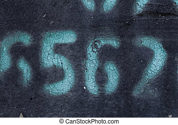 painted number on blak backdrop