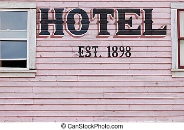 Painted pink historic hotel wooden facade siding