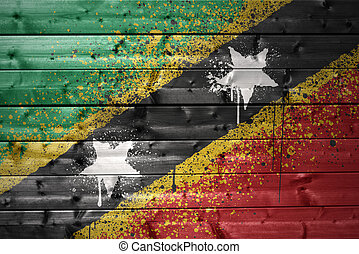 painted saint kitts and nevis flag on a wooden texture
