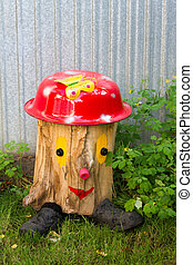 painted stump in the garden